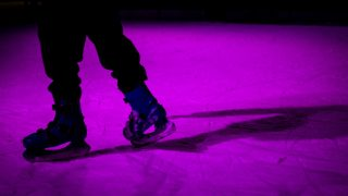 skates on ice rink purple lighting