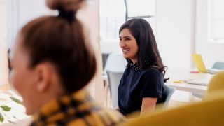 woman smiling in meeting