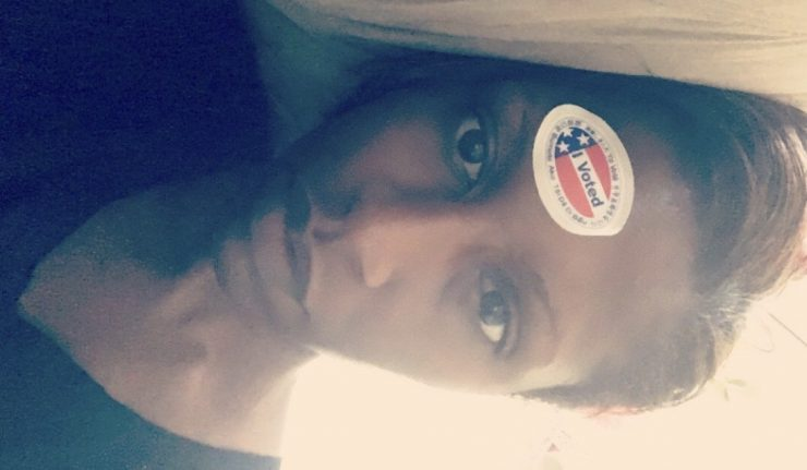 voted sticker on head