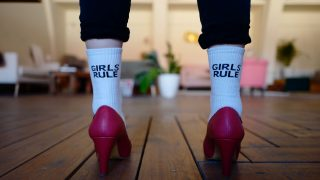 woman wearing girls rule socks